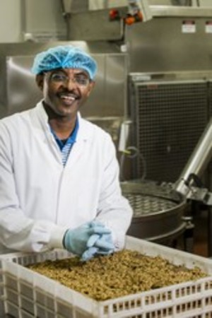 A man working in a food processing facility