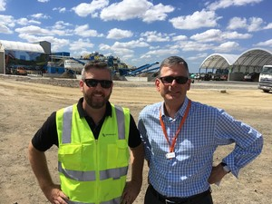 Jeffrey Canada, Repurpose It sales and materials supervisor with Brotherhood employer engagement coordinator Simon Gray standing at a rubbish tip