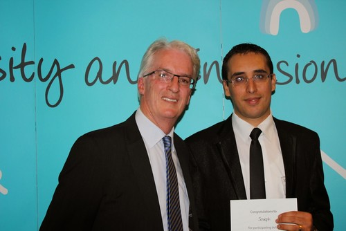 BSL Executive Director Tony Nicholson, left, with the Given the Chance 100th participant, Joseph.